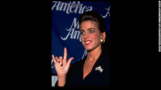 "Miss America 1995, Heather Whitestone, who is deaf, signs, ""I Love You"" to reporters at a press conference."