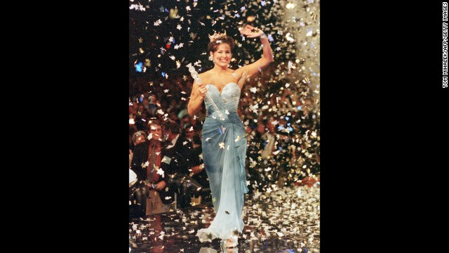 Heather Renee French, Miss America 2000, is showered with confetti as she walks down the runway after being crowned at the conclusion of the Miss America Pageant.