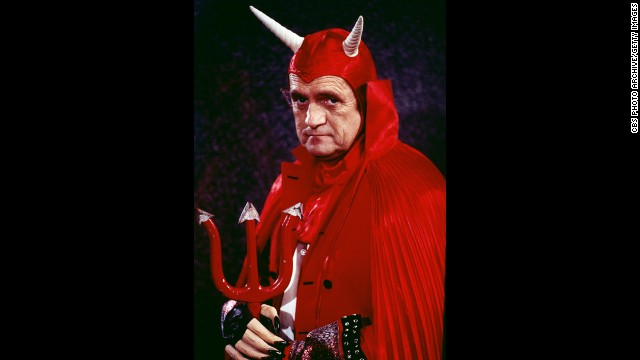 Known for mostly playing nice guys, Newhart poses as a dour devil with a red cape, pitchfork and horns in 1978.