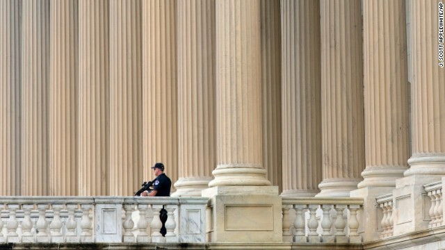 A U.S. Capitol Police officer keeps watch on the East Plaza of the Capitol in Washington.