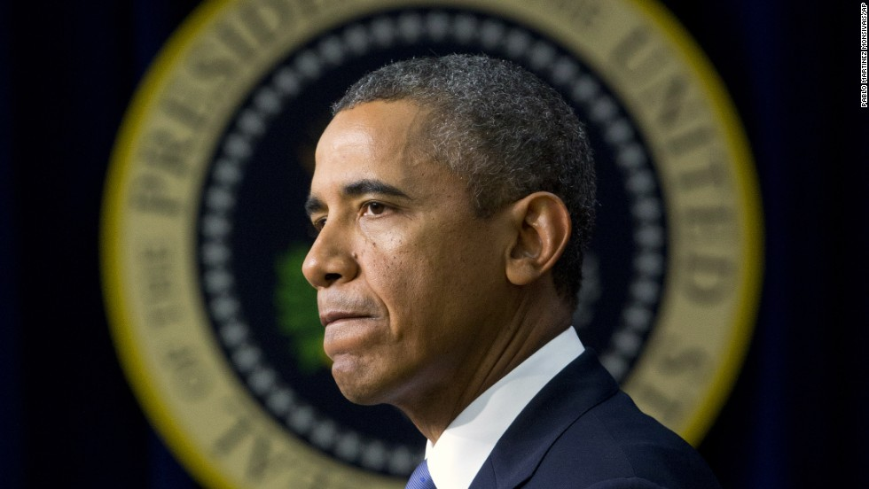"President Barack Obama pauses as he speaks in the South Court Auditorium on Monday, September 16, in Washington, about the shooting at the Washington Navy Yard, mourning what he called ""yet another mass shooting"" in the United States that he says took the life of American patriots."
