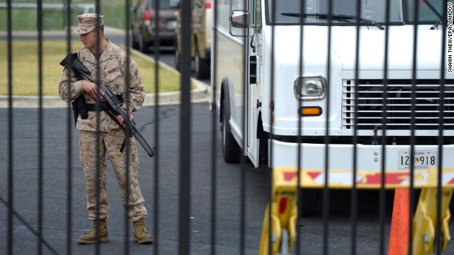 A member of the military stands guard at the scene of the shooting.