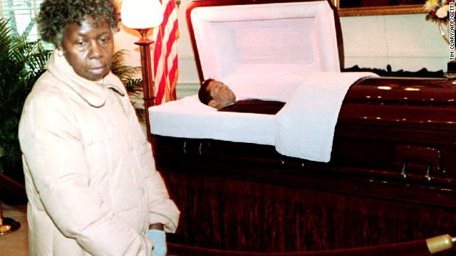 A mourner looks on as Ashe lies in state at the Governor's Mansion in Virginia before his burial on February 10, 1993.