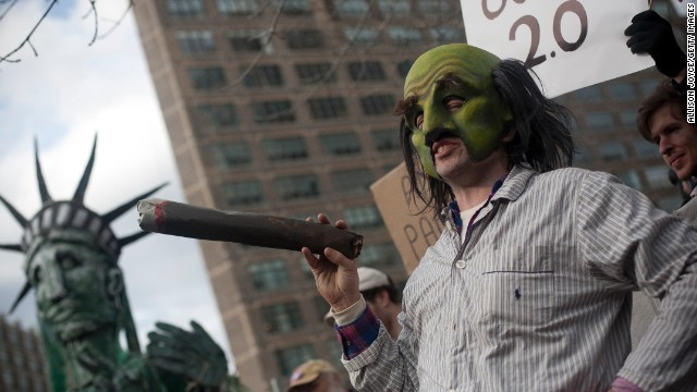 An Occupy Wall Street protester in 2011 stages a play as New York Mayor Michael Bloomberg.