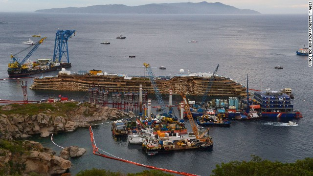 The wreckage of the Costa Concordia cruise ship sits near the harbor of Giglio, Italy, on Tuesday, September 17, after a salvage crew rolled the ship off its side.