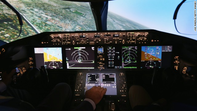 Pilots training to fly the Boeing Dreamliner will train on one of two 787 full-flight simulators, like the one shown here, at the company's training center in Miami. Capt. Gary Lee Beard is shown demonstrating one of the simulators on August 29 in Miami.