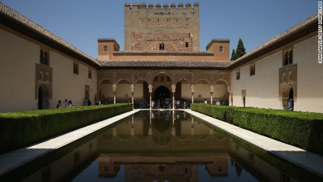 The reflecting pool in the Court of the Myrtles in the Nasrid Palaces at the Alhambra in Granada is a popular attraction.
