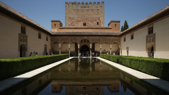 GRANADA, SPAIN - JULY 20: Visitors gaze at the reflecting pool in the Court of the Myrtles in the Nasrid Palaces at the Alhambra on July 23, 2013 in Granada, Spain. Southern Spain is among Europe's biggest tourist destinations.