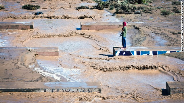 Christian Baste looks out at the flowing waters moving through the Swinburne Dam on the west side of Albuquerque, New Mexico, on September 13.