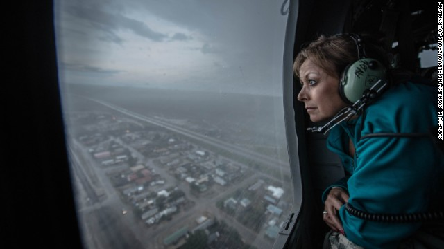 New Mexico Gov. Susana Martinez gets a bird's eye view of the city of Las Vegas from a Red Cross Blackhawk helicopter during a tour to assess the flood damage on Thursday, September 12.