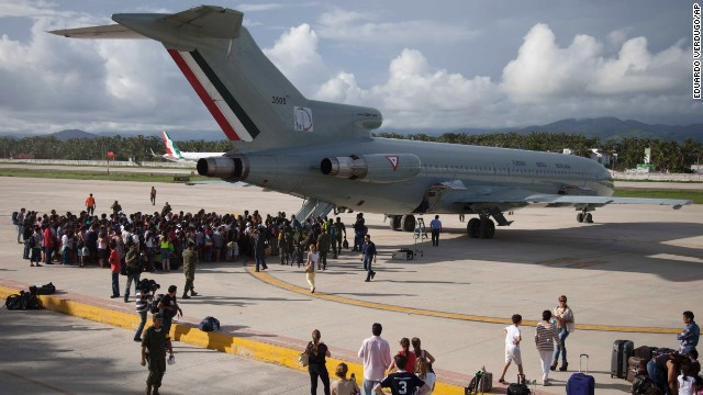 Stranded tourists gather around a Mexican air force plane at the air base in Pie de la Cuesta, near Acapulco, as they wait to be evacuated on September 17. An estimated 40,000 tourists were stranded in the Pacific state of Guerrero as dozens of roads were damaged and Acapulco's airport temporarily suspended services due to Hurricane Manuel.