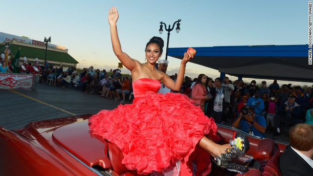 ATLANTIC CITY, NJ - SEPTEMBER 14: Miss America 2014 contestant Miss New York Nina Davuluri appears in the 2014 Miss America Competition Parade at Boardwalk Hall Arena on September 14, 2013 in Atlantic City, New Jersey.