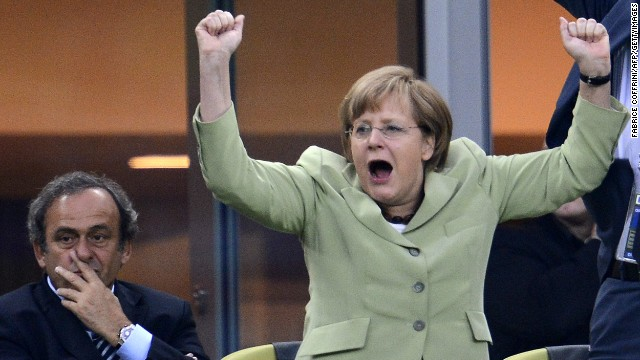 A big football fan, Merkel celebrates <a href='http://worldsport.blogs.cnn.com/2013/05/02/9100/'>Germany scoring a goal against Greece</a> during the Euro 2012 football championships quarter-final match in Gdansk .