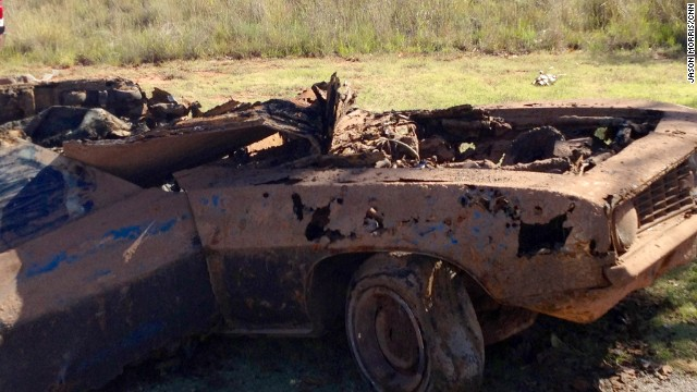 "The Camaro pulled from the lake is seen after investigators began their work. The sheriff removed remains ""one piece at a time,"" making an effort to ""keep them together."""