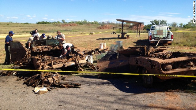 Investigators go through the vehicles in September 2013 to collect evidence as well as any human remains.