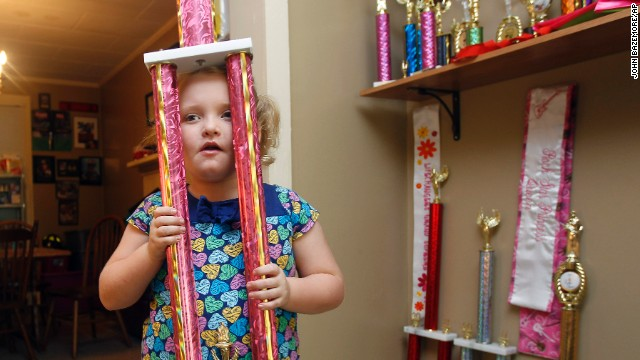 "Alana ""Honey Boo Boo"" Thompson became a household name after the now 8-year-old beauty pageant regular, seen here showing off one of her many pageant trophies, starred in her own reality show set in her rural hometown of McIntyre, Georgia."