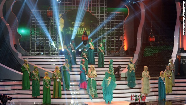 "Contestants in the World Muslimah 2013 competition perform onstage in Jakarta, Indonesia, on Wednesday, September 18. As an answer to the Miss World competition, the annual award was created to crown the woman who applies ""Islamic values in everyday life"" as Miss World Muslimah, according to the World Muslimah website."