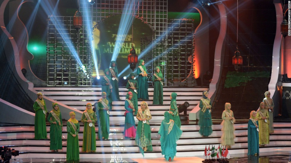 "Contestants in the World Muslimah 2013 competition perform onstage in Jakarta, Indonesia, on Wednesday, September 18. As an answer to the Miss World competition, the annual award was created to crown the woman who applies ""Islamic values in everyday life"" as Miss World Muslimah, according to the <a href='http://ads2.kompas.com/layer/muslimah/home' target='_blank'>World Muslimah website</a>."