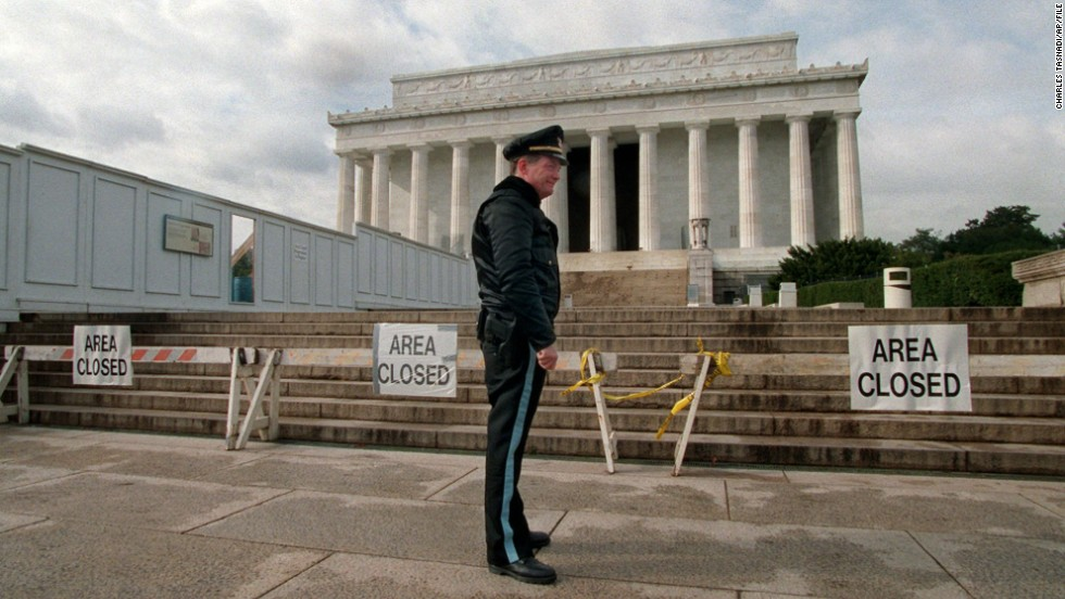 A Park Service police officer stands guard in front of the Lincoln Memorial during a partial shutdown of the federal government in November 1995. Many government services and agencies were closed at the end of 1995 and beginning of 1996 as President Bill Clinton battled a Republican-led Congress over spending levels.