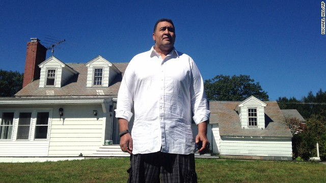 Former NFL offensive lineman Brian Holloway stands in front of his rural vacation home on Wednesday, September 18, in Stephentown, New York. Holloway