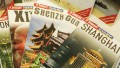 Tourist guidebooks are displayed at the stand of China