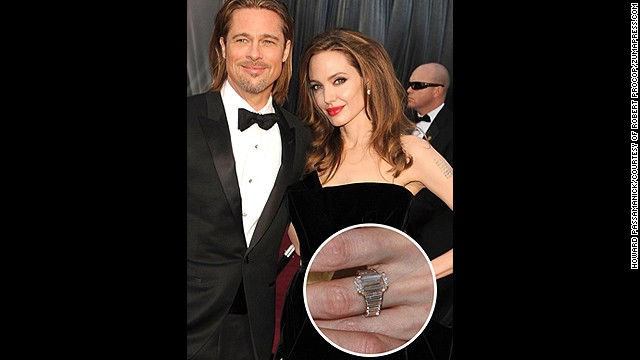 After seven years of dating, Brad Pitt popped the question with this 16-carat custom-designed Robert Procop diamond ring.