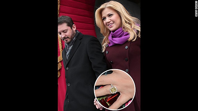 "The recently engaged Kelly Clarkson said ""yes"" after she was presented with this huge yellow diamond ring."