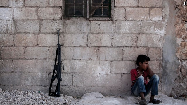 A Syrian child sits in a village in the Idlib province countryside on Septeptember 19.