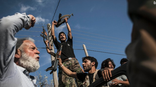 Opposition fighters react after returning from the battlefield in the Idlib province countryside on September 19.