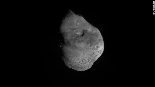 "The Deep Impact spacecraft sent a smaller ""impactor"" spacecraft into the orbit of comet Temple 1, causing it collide with the comet. Moments before impact on July 4, 2005, Tempel 1 is pictured in this composite image. Deep Impact is the most-traveled comet-hunter mission in history."