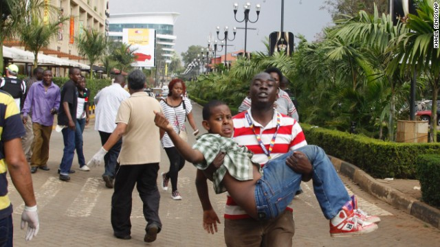 A rescue worker helps a child outside the Westgate Mall in Nairobi, Kenya Saturday, September 21. Gunmen burst into the mall and opened fire in a deadly attack. According to a senior Kenyan government source, the gunmen took an unknown number of hostages, and police are trying to negotiate for their release and retake the building. Several hours after the attack, Al-Shabaab, an al-Qaeda-linked militant group based in Somalia, claimed responsibility for the deadly attack.