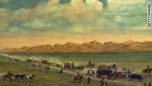 Painting by W.H. Jackson shows pioneers crossing the plains with the Sand Hills of Nebraska\'s Platte Valley in the background.