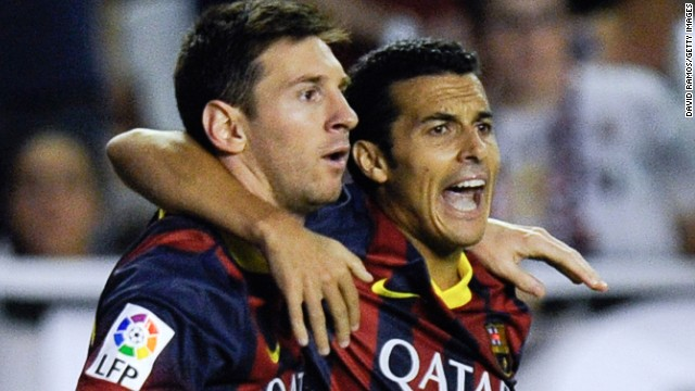 Barcelona's hat-trick hero Pedro Rodriguez (R) celebrates with Lionel Messi after scoring the opening goal against Rayo Vallecano.