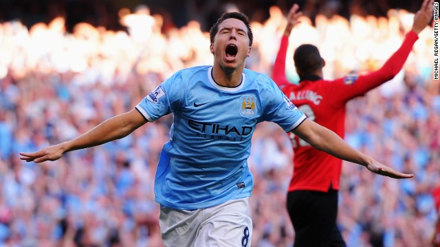 Nasri was criticized for his performance during City's 3-2 defeat in last season's home derby, but he played a key role in Sunday's 4-1 win. The France midfielder celebrates after scoring City's fourth goal.