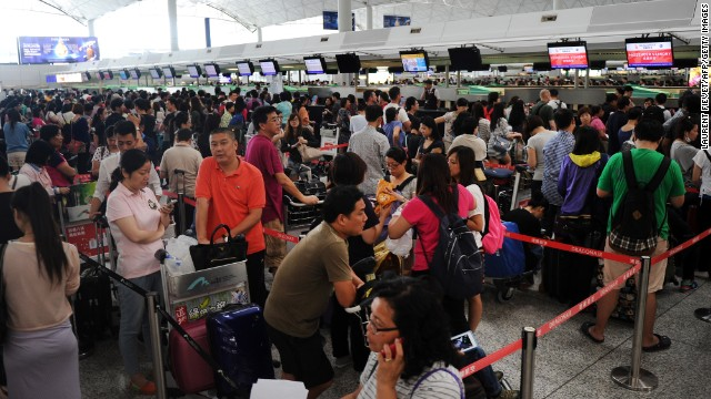 With thousands of passengers stranded, airlines and airport authorities were scrambling to deal with the backlog of flights at Hong Kong International Airport on September 22.