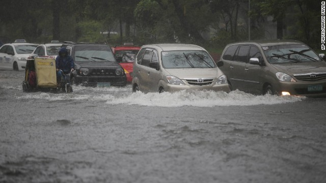 Typhoon Usagi floods streets in Manila, Philippines, as it sweeps through the Luzon Strait that separates the Philippines and Taiwan on September 22.