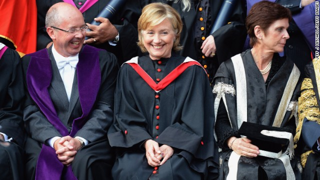 Clinton poses for pictures at St. Andrews University in St. Andrews, Scotland, on September 13. Clinton received an honorary degree from the university.