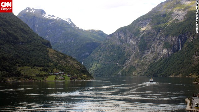 "A boat travels along a fjord in Geiranger. ""It is difficult to imagine that a more pristine, gorgeous land exists than <a href='http://ireport.cnn.com/docs/DOC-940021'>what we saw in Norway</a>,"" said Michael Gannon."