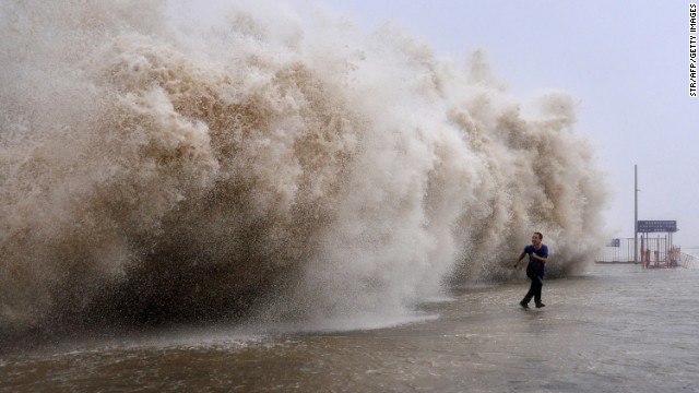 A man runs from a huge wave on a wharf in Shantou, China, on Sunday, September 22.