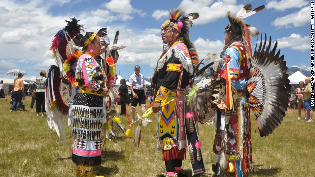 Native American dancers talk before competing in dance competitions at Taos Pueblo. The annual Taos Pueblo Pow Wow is one of the country's largest gatherings of Indian nations.