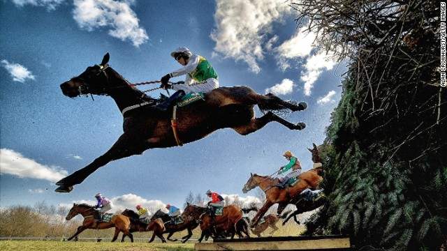 "Aintree, Liverpool, UK: Horses and jockeys negotiate the famous Bechers Brook fence during The John Smith's Foxhunters Steeple Chase. Crowhust took four cameras to Aintree in April, this year. ""I had three remote cameras and one in hand which sets off the other three. They're only jumping once, so you've got to make the most of the oportunity,"" he says. ""You get nice shapes in jumping as well when (the horses) stretch."""