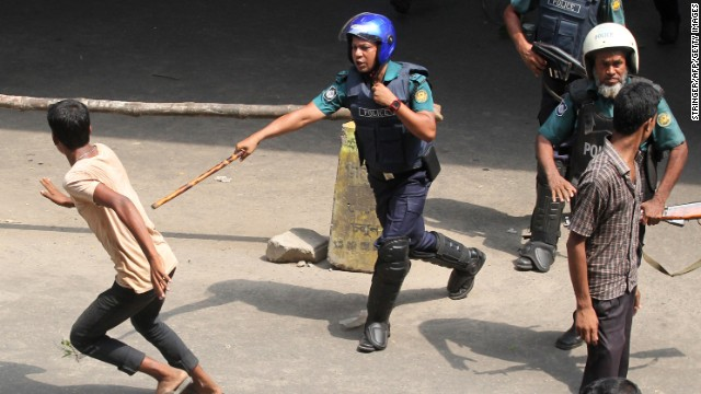 Police clash with protesting garment workers in Dhaka.