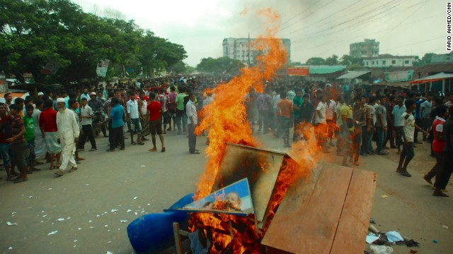 Protesters burn a desk and other items in Gazipur.