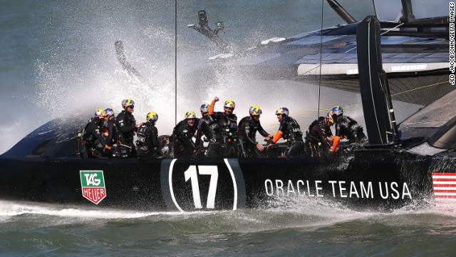 Oracle Team USA,skippered by James Spithill,celebrates after leveling the series with Emirates Team New Zealand.