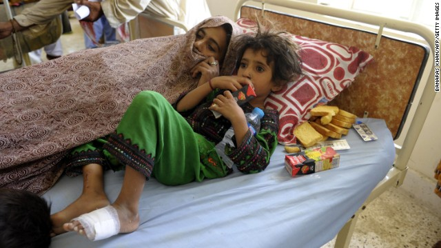 A family rests at a makeshift hospital in Awaran on September 25.