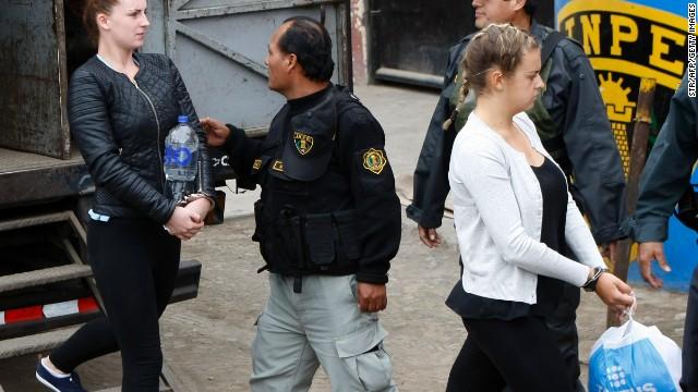 Defendants Michaella McCollum, left, and Melissa Reid walk into court in Callao, Peru, on Tuesday.