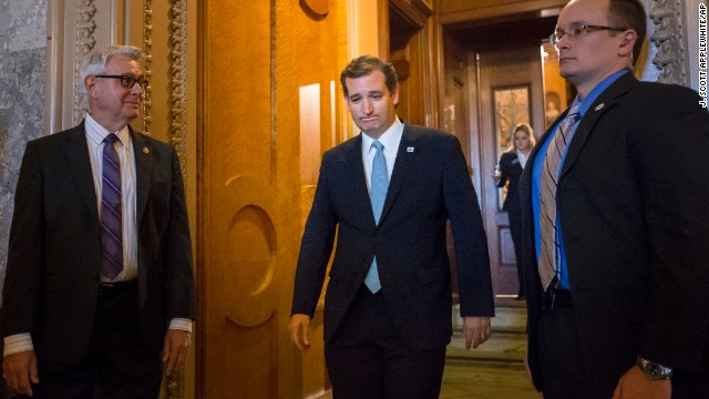 Cruz emerges from the Senate Chamber on September 25 after spending more than 21 hours railing against Obamacare.