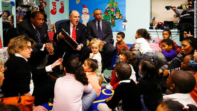 Former New York Mayor Rudy Giuliani reads a Christmas story to children at the Hale Learning Center in December 2007.