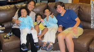 Frencis Velasquez\'s three children received new shoes from Nicholas Lowinger, right.
