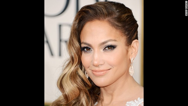 Jennifer Lopez delivers drama with radiant skin highlighted by makeup artist Mary Phillips.